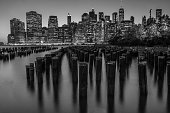 Black and white photo of the Manhattan Skyline from Brooklyn Bridge Park in New York City