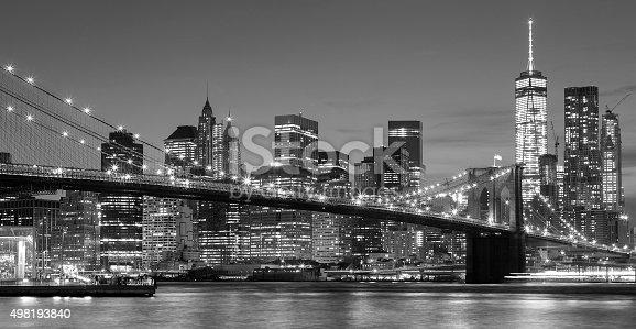 Black and white Manhattan waterfront at night, New York City, USA.