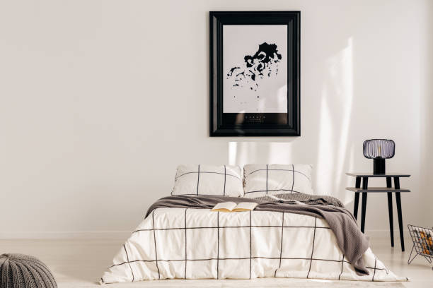 Black and white map in black frame in trendy bedroom interior with chequered bedroom – zdjęcie