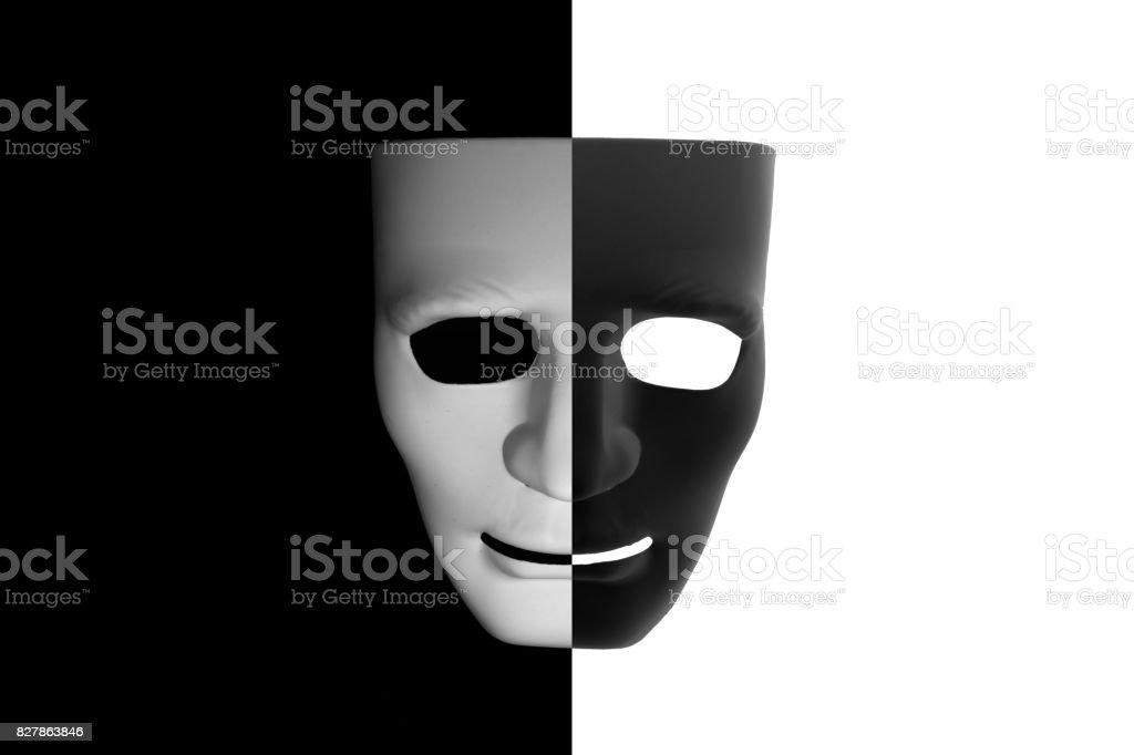 Black and white mask (half-half) on contrast background stock photo