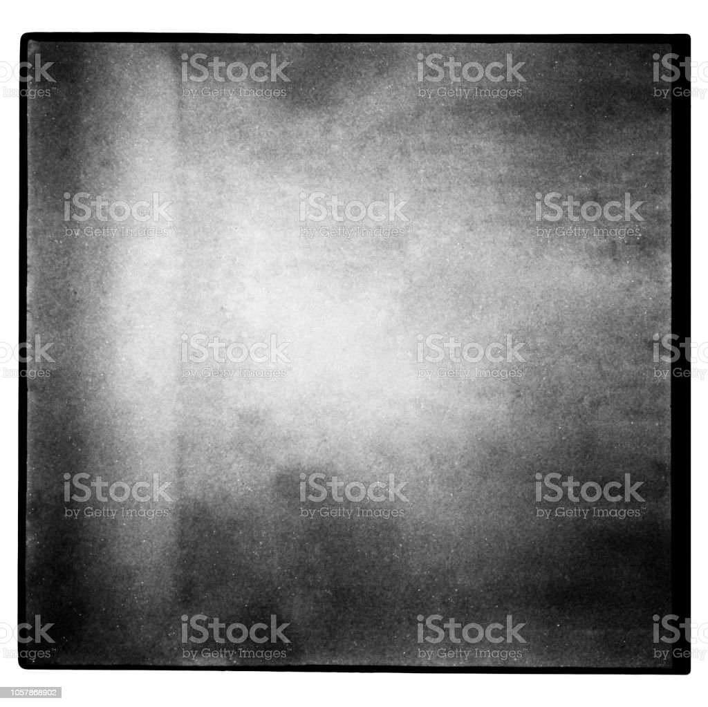 Black and white medium format film background with grain and light leak. stock photo