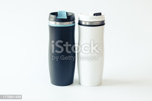 1129148925istockphoto Black and white metal travel mugs with a place for your design. Isolated. Mockup. Close up. 1170841439