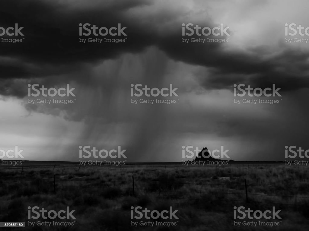 Black and White Monsoon Cloud and Rain Bands over Mountain on Horizon stock photo