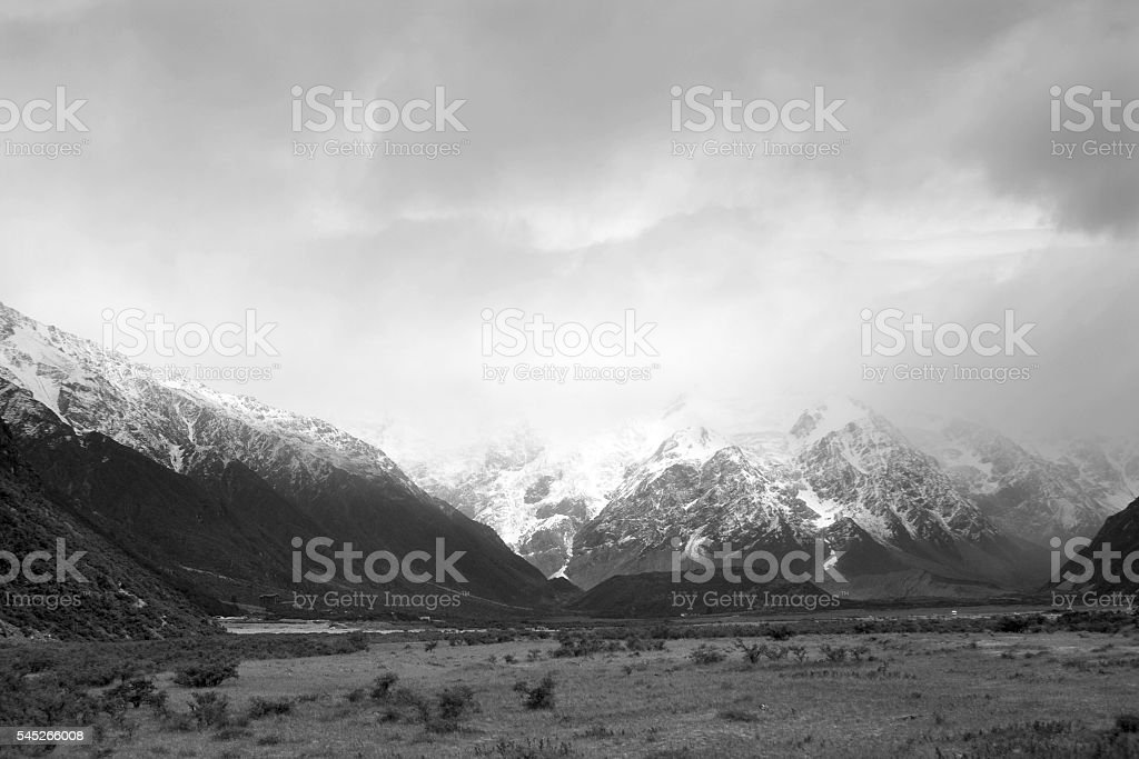 black and white Mount Cook Valley summer snow stock photo