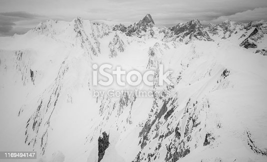 istock Black and white mountains winter scenery 1169494147
