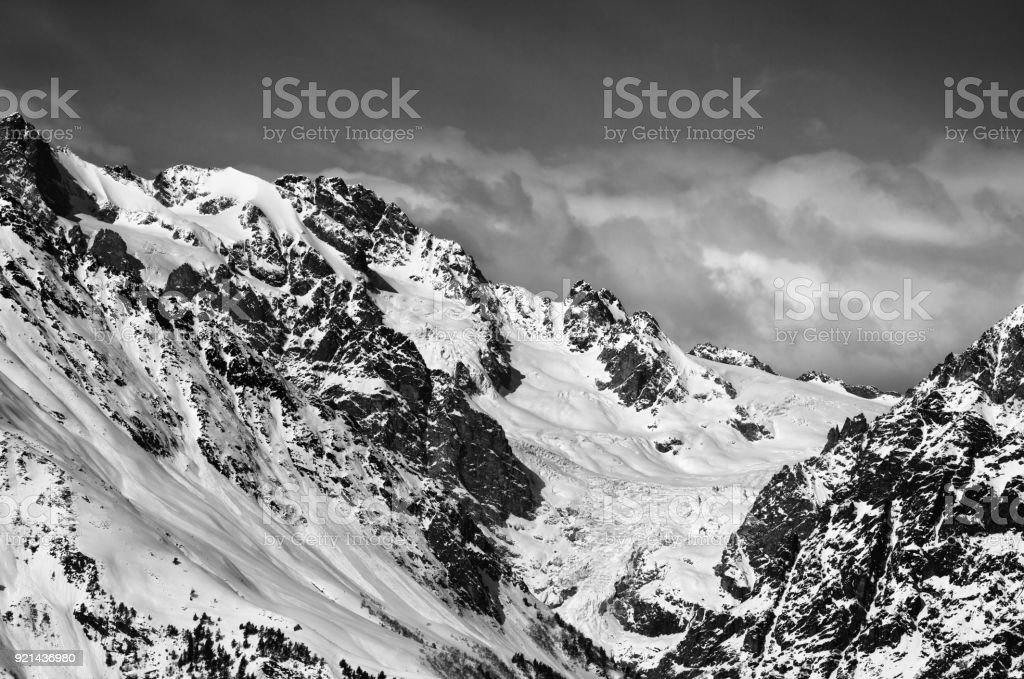 Black and white mountains with glacier in snow at winter sun day stock photo