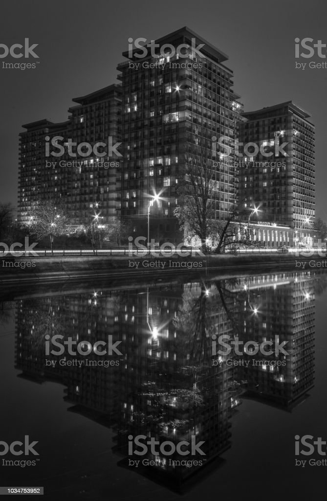 Black and white night shot with modern buildings stock photo