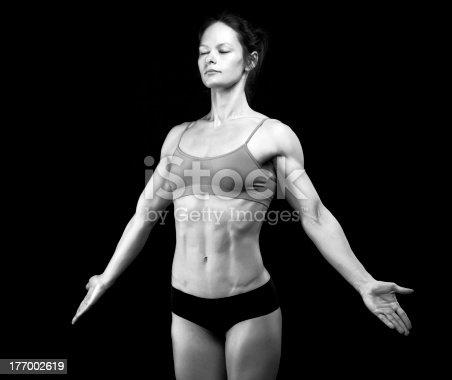 496193203 istock photo Black and white of female athlete on black 177002619