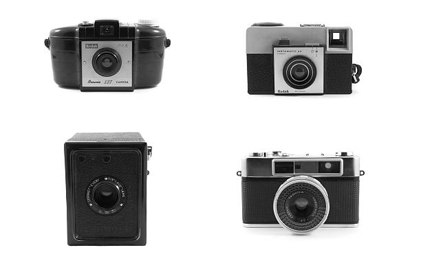 Black and white of four vintage cameras stock photo