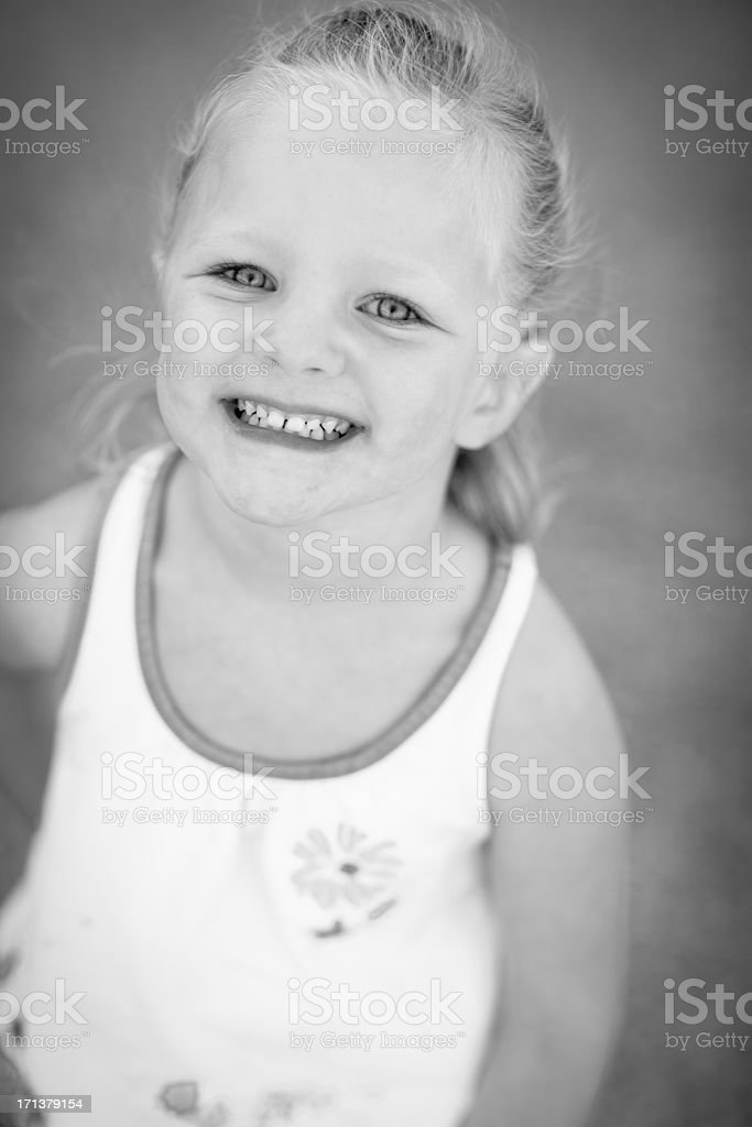 Black and White of Little Girl Standing Outside stock photo