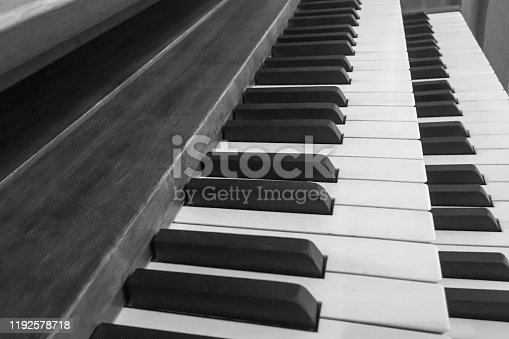 Full frame of pipe organ keyboard at church , in black and white color
