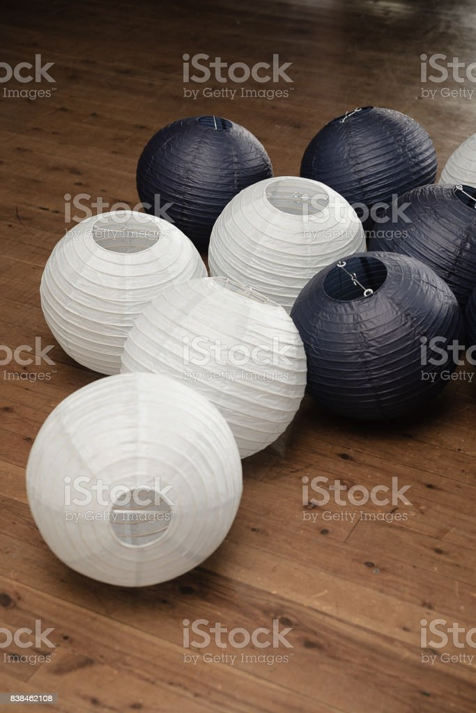 Black And White Paper Lanterns On A Hardwood Floor Stock Photo Download Image Now Istock