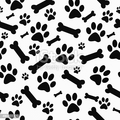 istock Black and White Paw Prints and Bones Pattern Repeat Background 490222720