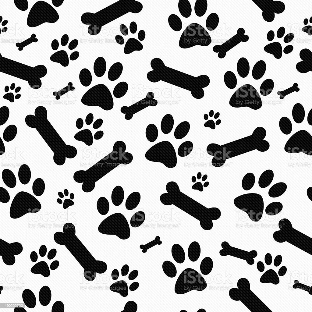 Black and White Paw Prints and Bones Pattern Repeat Background stock photo
