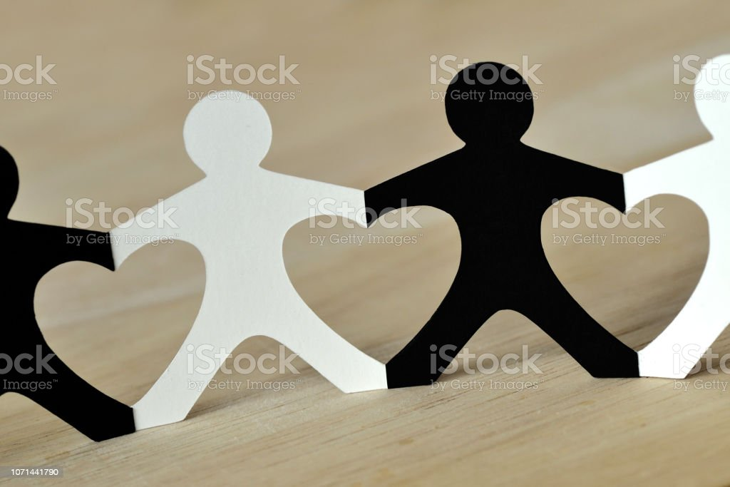 Black and white people chain made of paper - Anti-racism concept stock photo