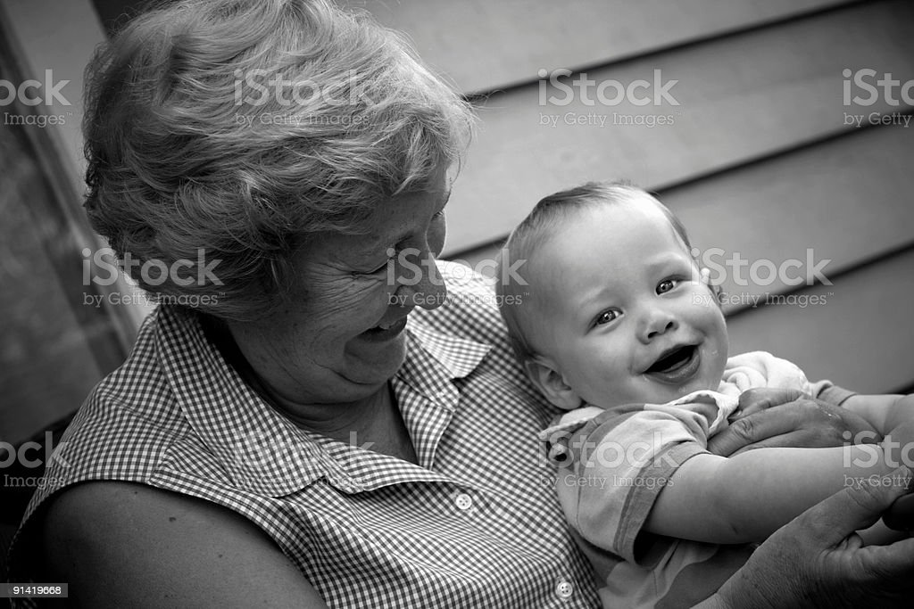 A black and white photo of a baby and parent stock photo