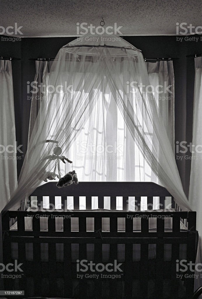 Black and white photo of a crib in a baby bedroom royalty-free stock photo