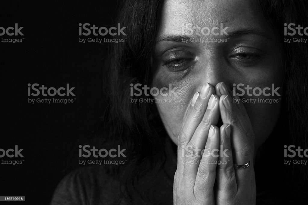 Black and white photo of a domestic violence victim stock photo