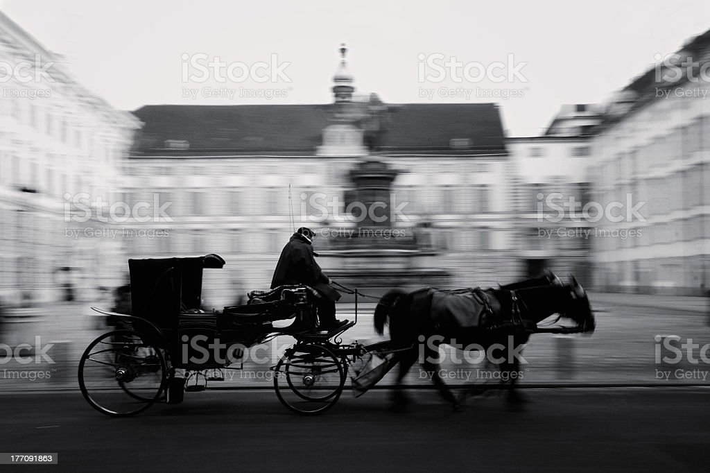 A black and white photo of a horse-driven carriage in Vienna stock photo