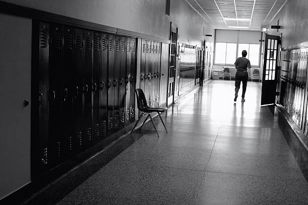 Black and white photo of a school hallway picture id172221243?b=1&k=6&m=172221243&s=612x612&w=0&h=u6nownx9ju6vxnlmw5nvmxcphv4 jpl29i3wxzcb90o=