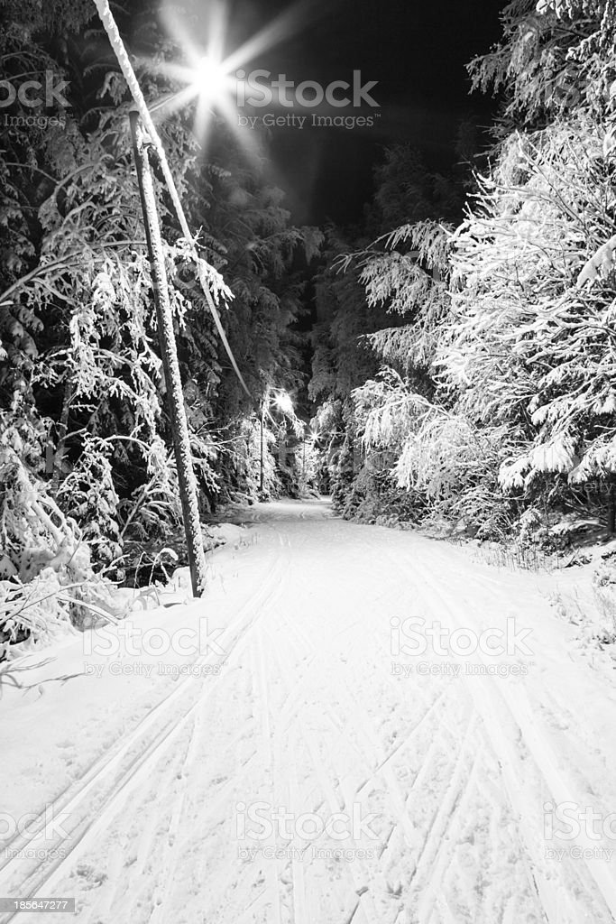 Black and white photo of a ski track at night stock photo