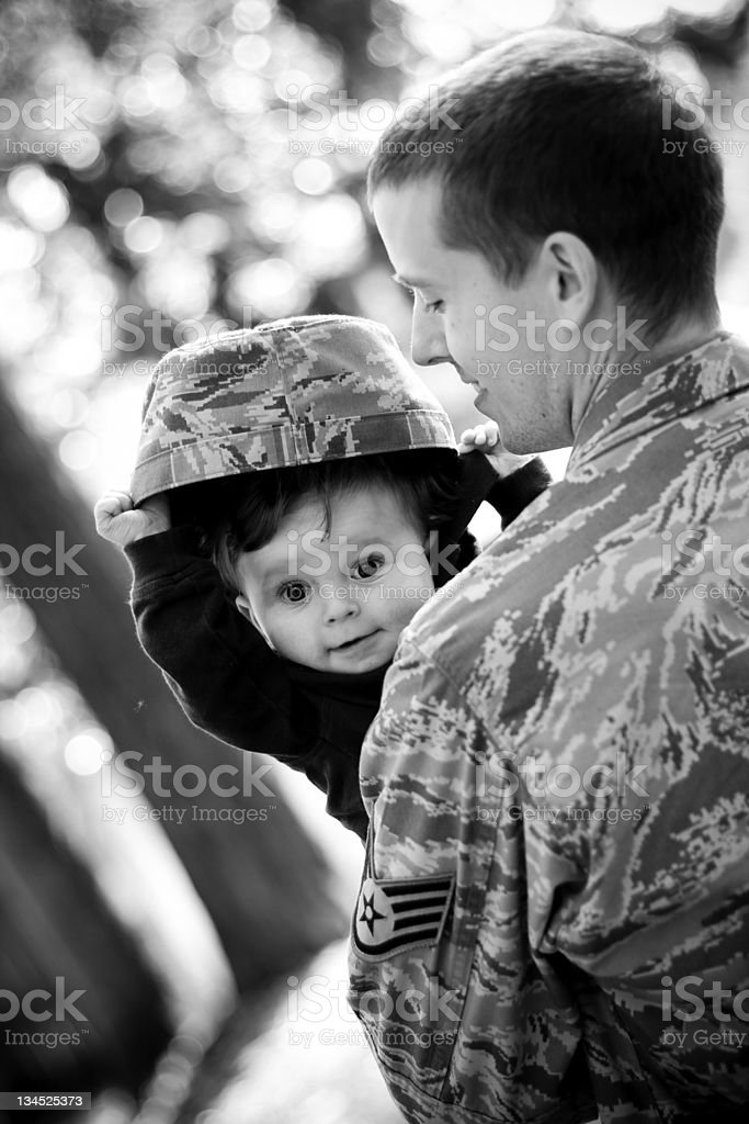 Black and white photo of a soldier and his son stock photo