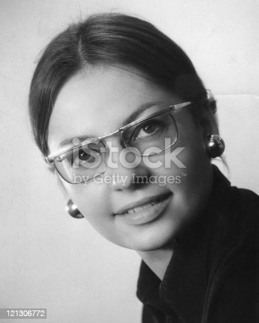 istock A black and white photo of a young woman in glasses 121306772