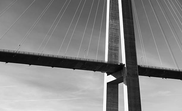 Black and white photo of cable-stayed bridge stock photo