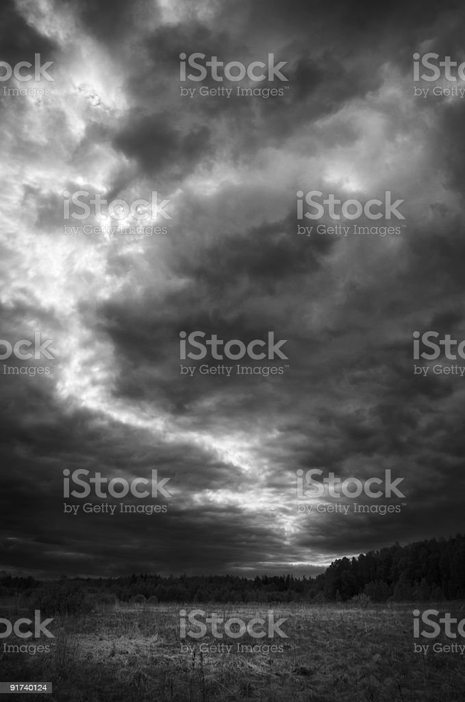 Black and white photo of clouds parting to create a path  royalty-free stock photo