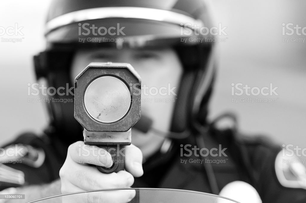 Black and white photo of cop with speed gun stock photo