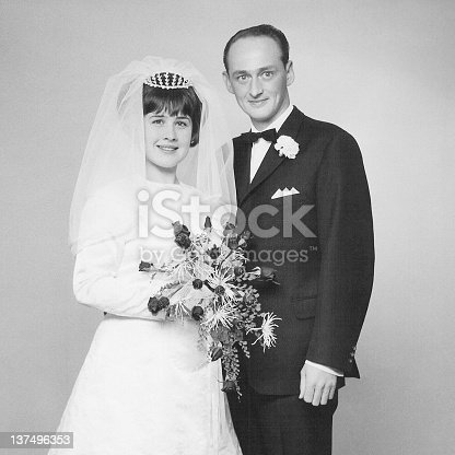 Vintage portrait of a caucasian couple on their wedding day back in 1966.