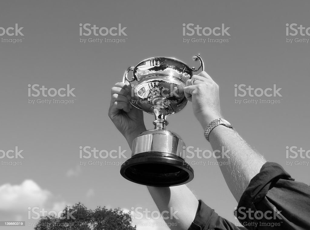 Black and white photo of hands holding up a trophy royalty-free stock photo