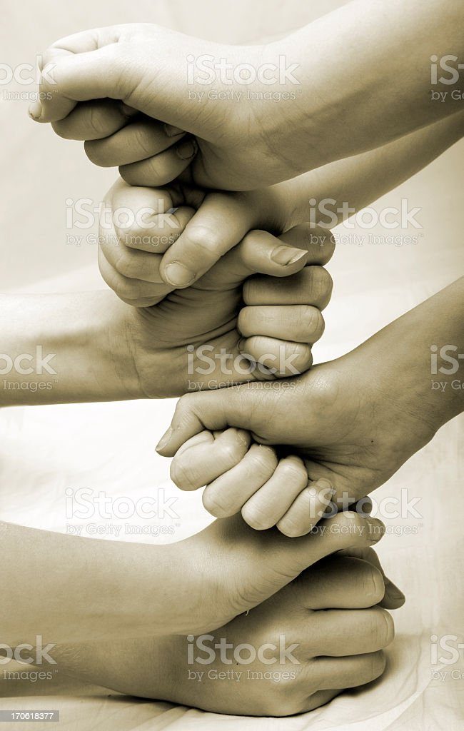 Black and white photo of hands on top of each other royalty-free stock photo