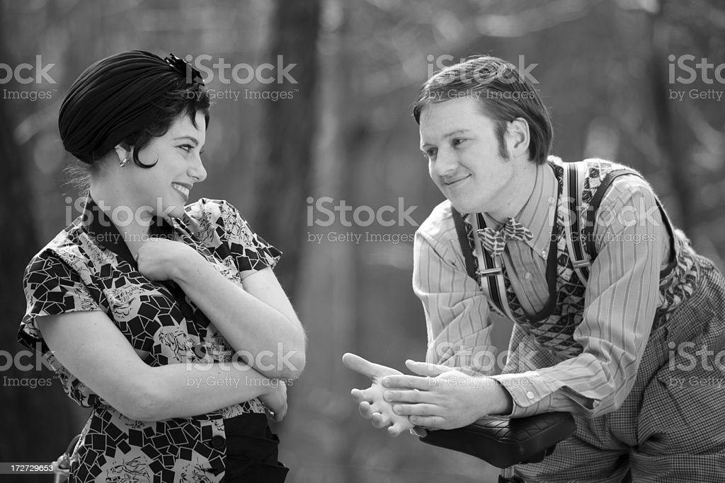 black and white photo of man flirting with a lady royalty-free stock photo