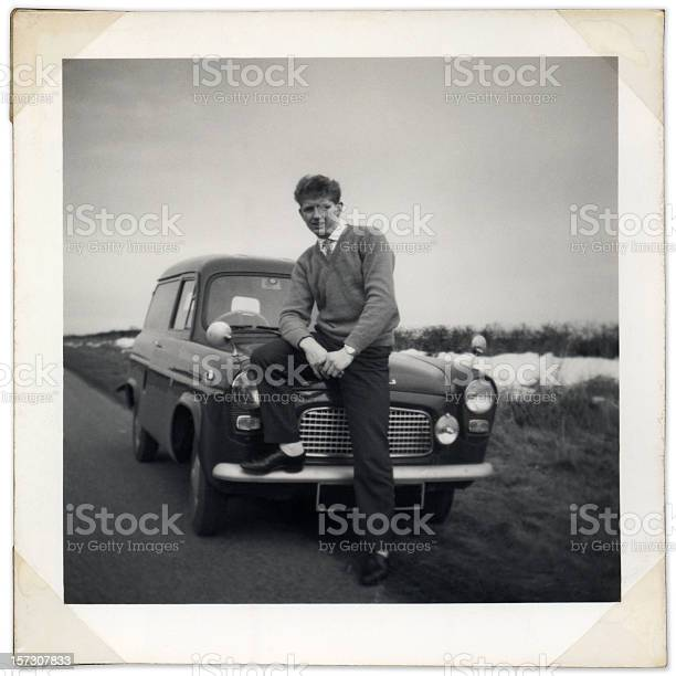Black and white photo of man sitting on vintage car bonnet picture id157307833?b=1&k=6&m=157307833&s=612x612&h=a488rxhhg6je2ajt1lhgmjqw6c2mlteapufmfo9gluy=