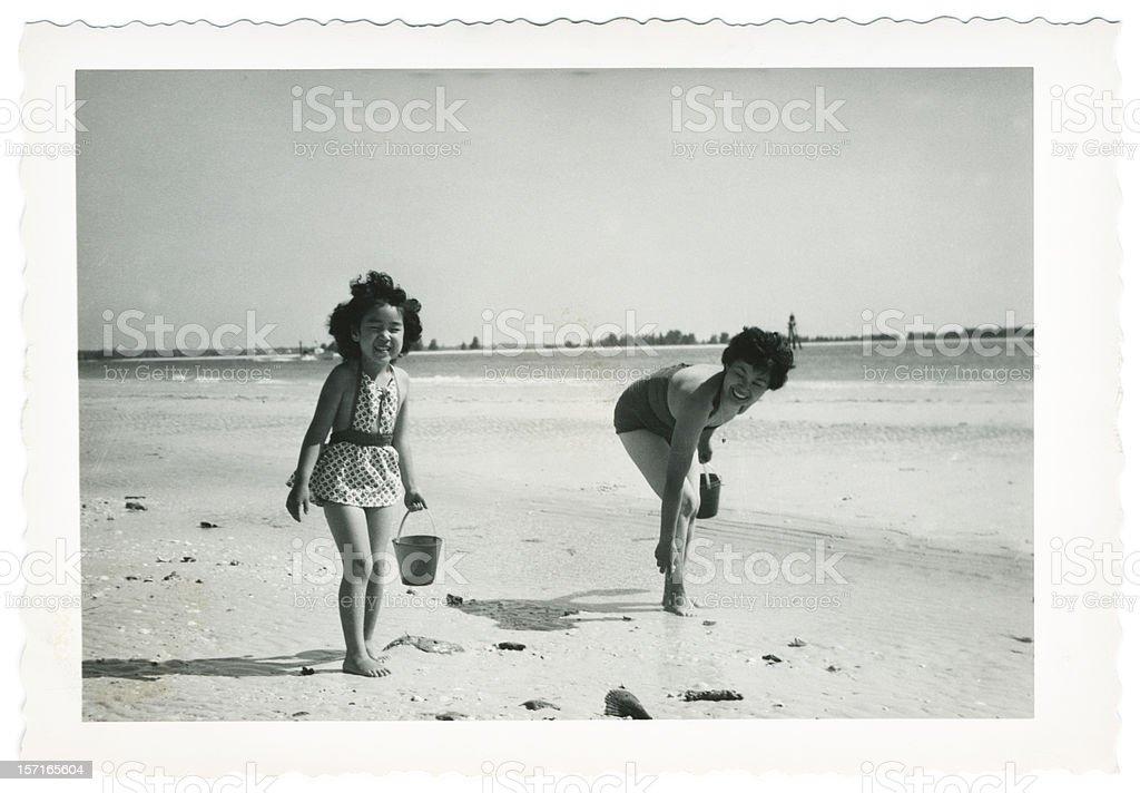 Black and White Photo of Picking Up Shells stock photo