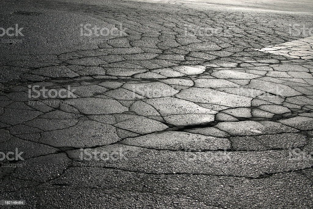 Black and white photo of severely cracked concrete royalty-free stock photo