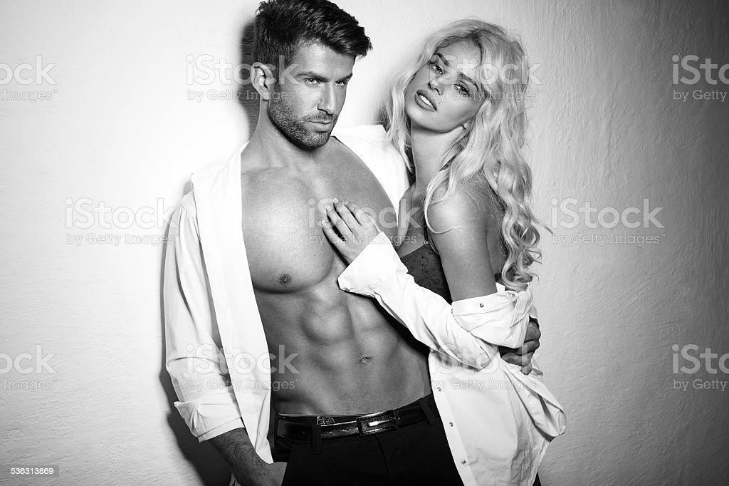 Black and white photo of sexy couple stock photo