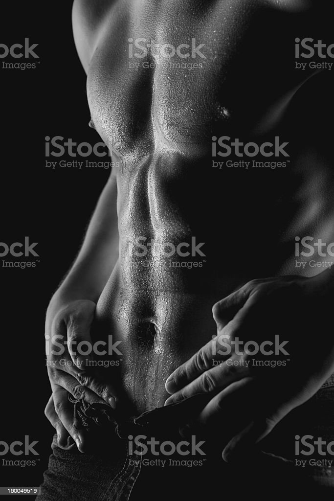 black and white photo of sexy muscular naked man stock photo