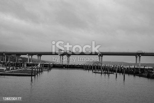 Black and white photo of Tappan Zee bridge on Hudson river on a misty, foggy day