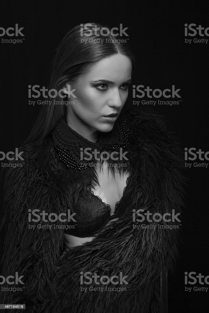 Black and white photo of the girl with fur around stock photo
