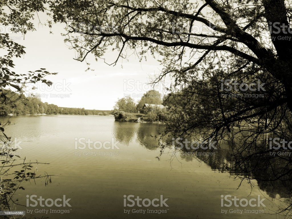 Black and white photo. The big river in the village. Vintage background. stock photo