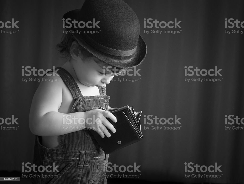 Black and white picture of a boy looking inside a wallet royalty-free stock photo