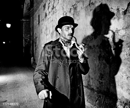 Man dressed up as famous detective Sherlock Holmes outdoors, including typical shadow  Note: All props in this shoot including pipe are authentic vintage items. Slight light trails and motion blur on arms. Black and White. Grain Added.  [url=file_closeup.php?id=13571687][img]file_thumbview_approve.php?size=1&id=13571687[/img][/url] [url=file_closeup.php?id=13548314][img]file_thumbview_approve.php?size=1&id=13548314[/img][/url] [url=file_closeup.php?id=13548292][img]file_thumbview_approve.php?size=1&id=13548292[/img][/url] [url=file_closeup.php?id=13548271][img]file_thumbview_approve.php?size=1&id=13548271[/img][/url] [url=file_closeup.php?id=13548249][img]file_thumbview_approve.php?size=1&id=13548249[/img][/url] [url=file_closeup.php?id=13548231][img]file_thumbview_approve.php?size=1&id=13548231[/img][/url] [url=file_closeup.php?id=13894179][img]file_thumbview_approve.php?size=1&id=13894179[/img][/url] [url=file_closeup.php?id=13894166][img]file_thumbview_approve.php?size=1&id=13894166[/img][/url]