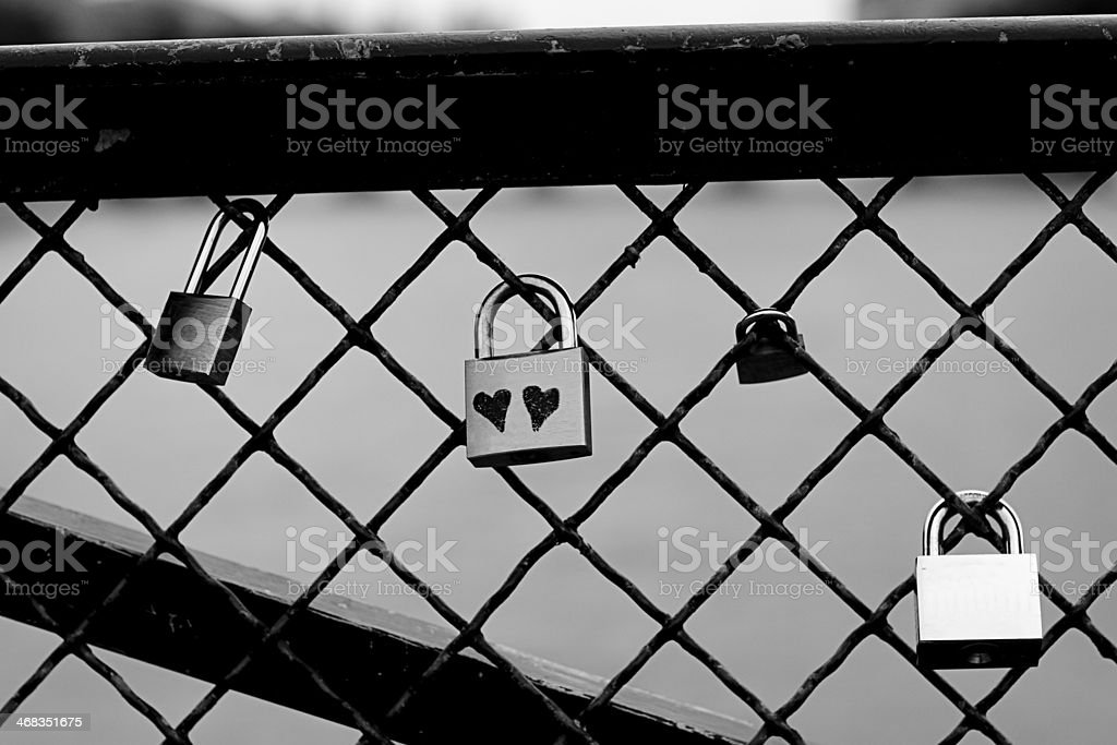 Black and white picture of a lock with two hearts royalty-free stock photo