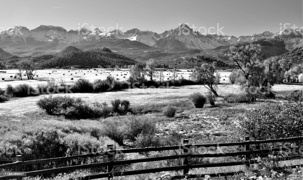 Black and White Picture of Colorado Mountains and Hay Field stock photo