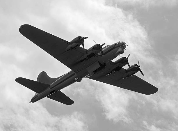 Black and white picture of old bomber plane World War II era heavy bomber on a mission bomber plane stock pictures, royalty-free photos & images
