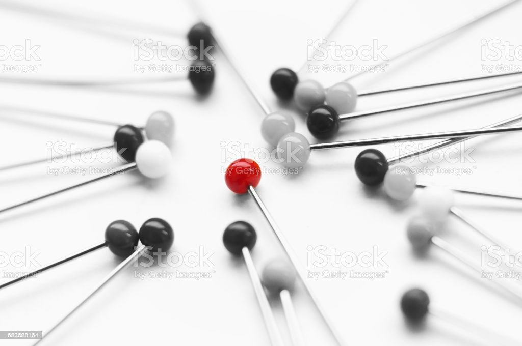 black and white pins - one red pinhead - Photo