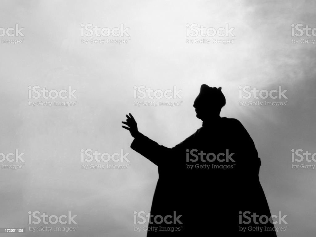 Black and white pope holding hand out and waving stock photo