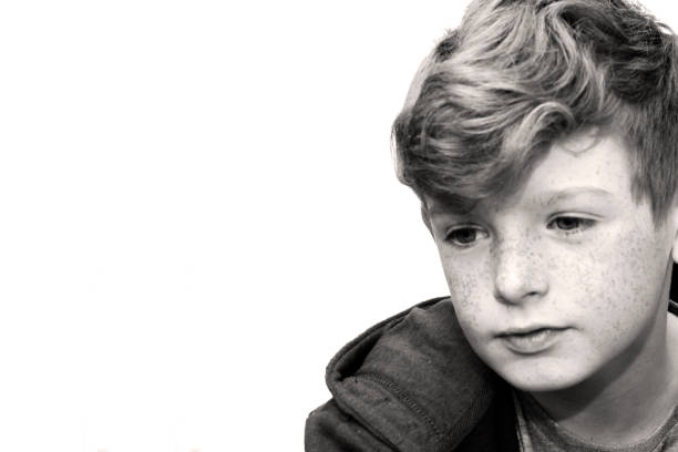 Black and white portrait of a boy stock photo